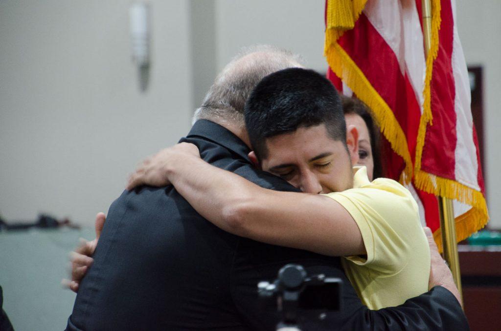 Kevin Palacios hugs Steve Probst