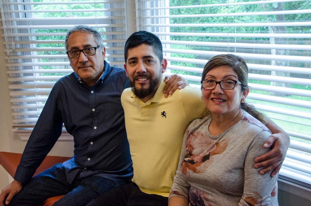 Kevin Palacios, surrounded by his parents